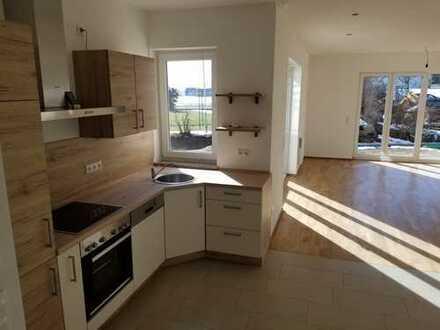 Neuwertige 3-Zimmer-Erdgeschosswohnung mit Terrasse, Garten und Einbauküche