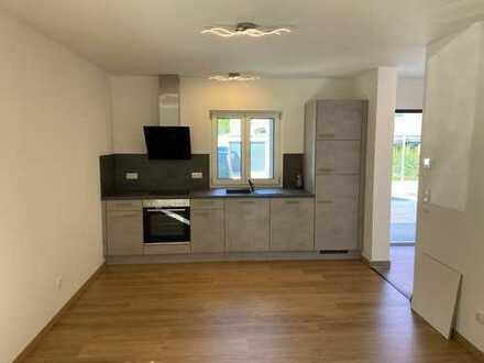 Erstbezug: exklusive 1-Zimmer-EG-Wohnung mit Einbauküche und Terasse in Ismaning