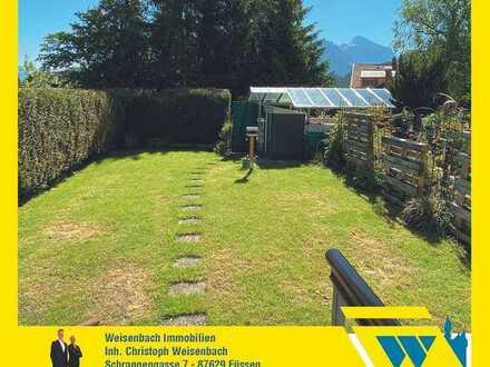 Sonnig und bevorzugt gelegene 2-Zimmer-Wohnung mit herrlichem Bergblick und schönem Garten