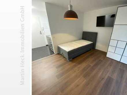 Kernsanierte, hochwertige, möblierte 1 Zimmer Wohnung mit Tiefgaragenstellplatz in zentraler Lage !
