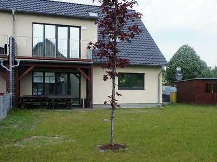 EG Wohnung mit großem Garten in DHH, zentrumsnah