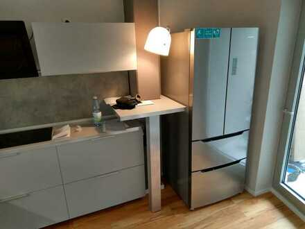 Moderne 2 ZKB Wohnung mit Einbauküche und TG-Stellplatz in zentraler Lage