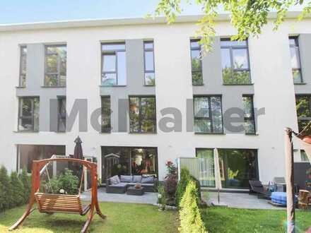 Gehoben Wohnen: Modernes RMH mit Garten und Terrasse in ruhiger Lage