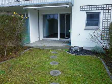 Traumhafte 2,5-Zimmer Wohnung mit Garten und zwei Tiefgargenstellplätze