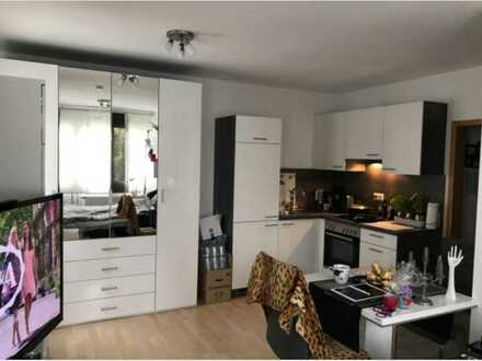 Geschmackvolle teilmöblieret 1-Raum-Erdgeschosswohnung mit Terrasse und EBK