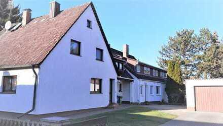2 Doppelhaushälften auf einem Grundstück mit 620 m² in Alterlangen