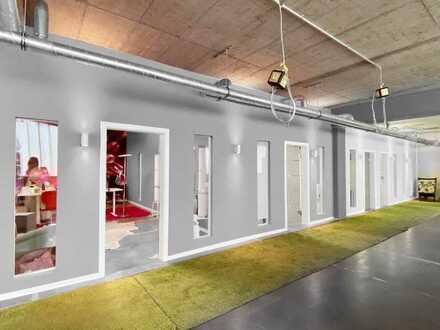 moderner, offener Bürobereich mit Gemeinschaftsflächen (KA-Mühlburg)