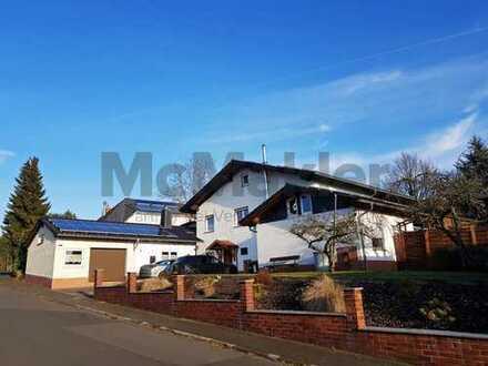 Großzügiges Zweifamilienhaus mit großer Garage/Werkstatt in Allendorf-Winnen!
