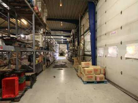 Verkaufs- und Lagerfläche + Freifläche: Gewerbeimmobilie im Industriegebiet