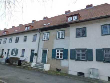 Grundstück mit leerstehenden, umfangreich sanierungsbedürftigen Reihenmittelhaus:Kirchmöser