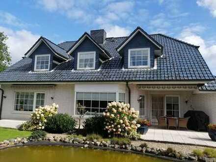 Äußerst ansprechendes Einfamilienhaus mit ebenerdiger Einliegerwohnung u. Keller in Kisdorf