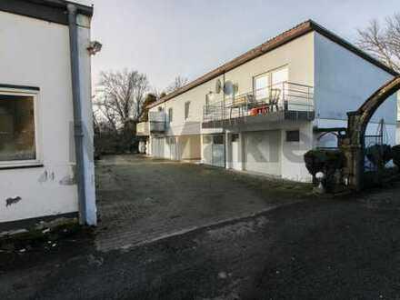 Vielfältiges Nutzungspotenzial: Vermietetes MFH mit 5 Garagen und 6 Außenstellplätzen