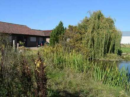 Bungalow mit 400 m² Teich im Außenbereich