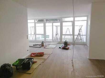Großzügige 2 - Zimmerwohnung mit kleinem Innenhof, mitten in der City, Erstbezug nach Modernisierung