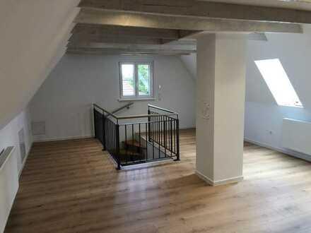 Erstbezug nach Sanierung mit Balkon: stilvolle 4-Zimmer-Maisonette-Wohnung in Würzburg-Sanderau