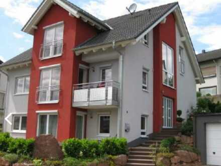Gepflegte Wohnung mit drei Zimmern sowie Balkon und Einbauküche in Stadtprozelten