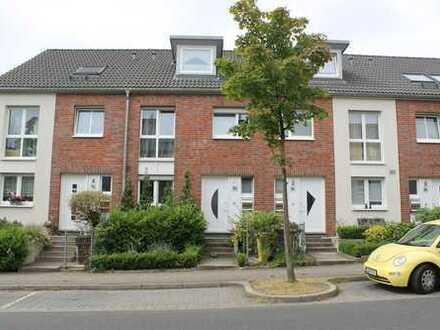 Familienfreundliches Reihenmittelhaus mit Südwestgarten und Garage in Düsseldorf, Wittlear
