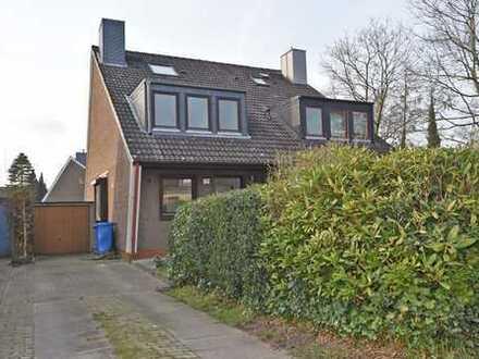 Charmante Doppelhaushälfte mit moderner Ausstattung, Garage und schönem Grundstück