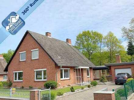 Gepflegtes Siedlerhaus mit Anbauten und schönem Garten in Karby