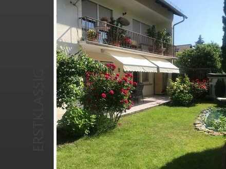 Wunderschöne EG-Wohnung mit Terrasse, Garage + Carport
