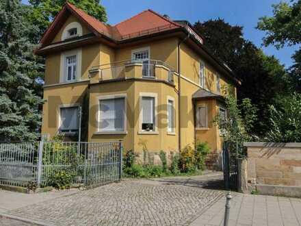 Wohn- und Geschäftshaus mit vielversprechendem Baugrundstück in gefragter Wohngegend