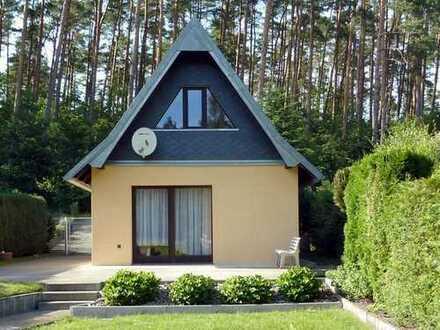 Hochwertiges Ferien- und Wochenendhaus in ruhiger Waldrandlage mit traumhaftem Ausblick.