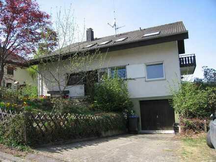 3 Zimmer-Erdgeschosswohnung mit Gartenanteil, breitem Panoramabalkon und Garage im 2-Fam.Haus