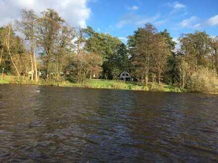 RESERVIERT: Am Fluss gelegenes Grundstück mit Häuschen und weiterem Baufenster in Winsen (Aller)