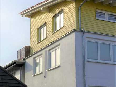Wohn- und Geschäftshaus in Freiburg-Opfingen