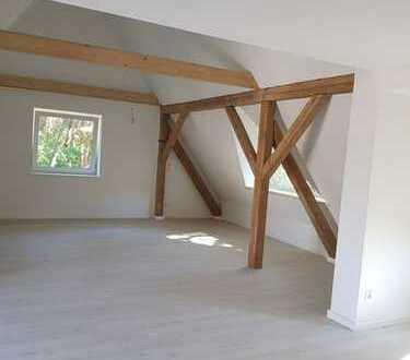 Erstbezug nach Sanierung mit 2 Balkonen: schöne Dachgeschosswohnung mit Schlafboden in Bestensee