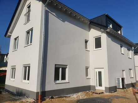 Erstbezug: attraktive 3-Zimmer-EG-Wohnung mit Terrasse und Garten