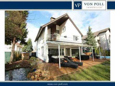 Außergewöhnliches Einfamilienhaus mit Sonnengrundstück in Top-Lage