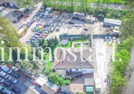 GELEGENHEIT: Gewerbeimmobilie mit ca. 5.400 m² Grundstück, Halle, Haus & Garagen.