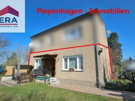 Käuferprovisionsfrei! Großzügige Wohnung im EG mit Garage, Gartenanteil und Wasserblick!