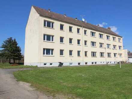 Sonnige, teilsanierte Wohnanlage mit 12 WE und 12 Garagen in ruhiger Lage von Köckritz