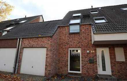 Helle Doppelhaushälfte mit Garten und Terrasse.