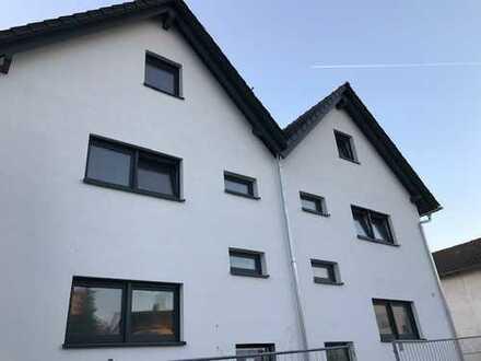 Erstbezug einer hellen Tiefgeschosswohnungmit Tiefhof: attraktive 2,5-Zimmer-Wohnung in Seligenstadt