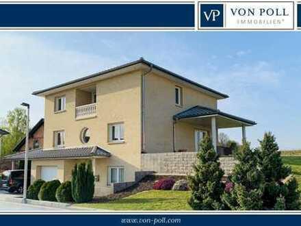 Baunatal-Kirchbauna: Neuwertiges Einfamilienhaus mit Garage und pflegeleichtem Grundstück