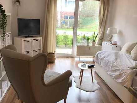 Gemütliche, helle 1-Zimmer-Wohnung im Erdgeschoss mit Terrasse und Einbauküche