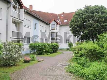 Ruhige Lage am Krummer See: Vermietete 3-Zi.-ETW mit Südwest-Balkon und Garagen-Stellplatz