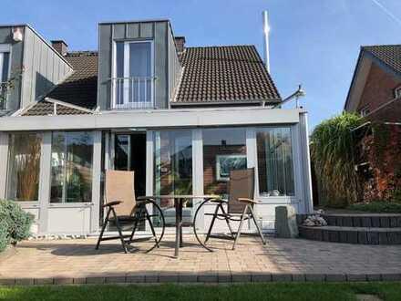 Gepflegte Doppelhaushälfte mit Kamin & Wintergarten in Steinhagen - zentral | naturnah | ruhig