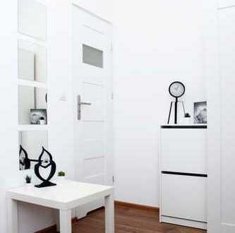 Vollständig renovierte, vermietete 7-Zimmer-Wohnung mit 2 Balkons und EBK in Kattowitz 8% Rendite!