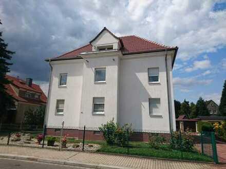 Gepflegte 4-Zimmer-Wohnung mit Garage und Garten
