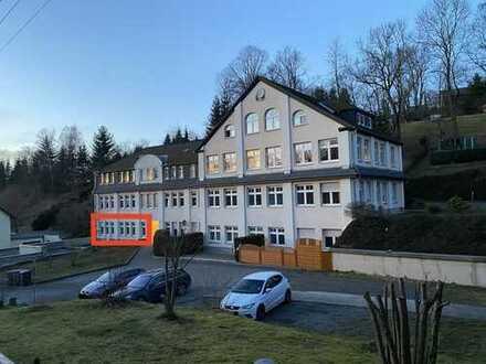 ETW im Erdgeschoss mit Terrasse in gepflegtem Mehrfamilienhaus
