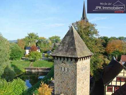Wohn- und Geschäftshaus mit Weserblick