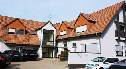 Mehrfamilienhaus mit Gewerbeeinheit und Stellplätzen in Karlsruhe- Daxlanden