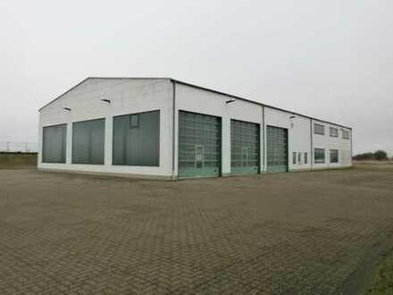 Werkstattgebäude mit Büro, Lageranteil, Waschplatz und Freiflächen zu vermieten