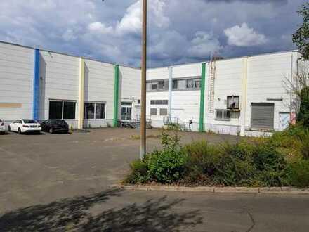 Ca. 1000 qm Hallenfläche mit Aussenanlage als Lager, Verkauf etc. zu vermieten