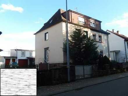 Doppelhaushälfte mit Nebengebäude in zentrumsnaher Lage
