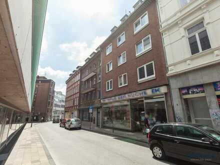 Voll vermietetes MFH mit 7 Wohnungen, Ladenlokal und Ausbaupotenzial im Dachgeschoss in Aachen
